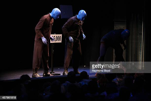 Blue Man Group performs during a special AutismFriendly performance at the Briar Street Theatre on October 26 2014 in Chicago Illinois