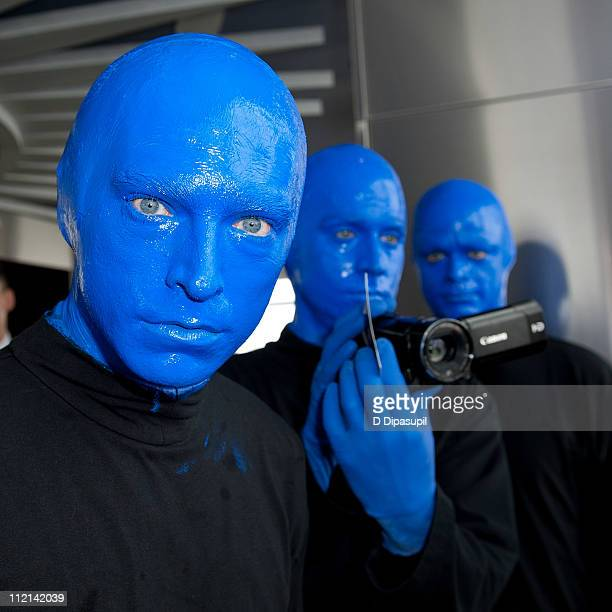 Blue Man Group visits The Empire State Building on April 13, 2011 in New York City.