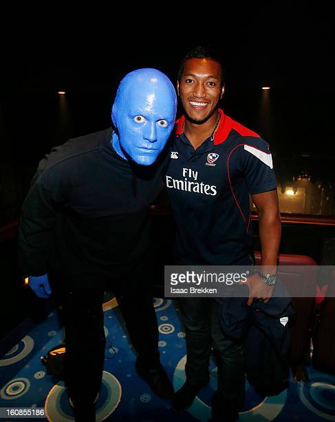 Blue Man Group welcomes USA Sevens Rugby players Shalom Suniula right at Monte Carlo Resort and Casino on February 6 2013 in Las Vegas Nevada