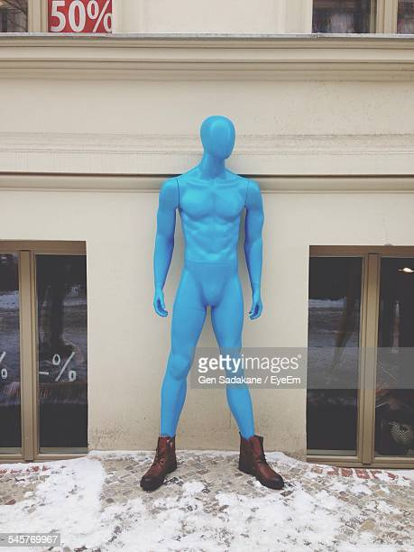 Blue Mannequin Outside Store