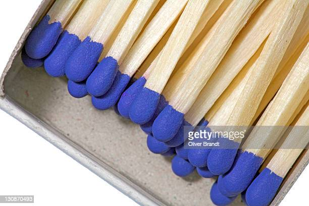 Blue matches in open box