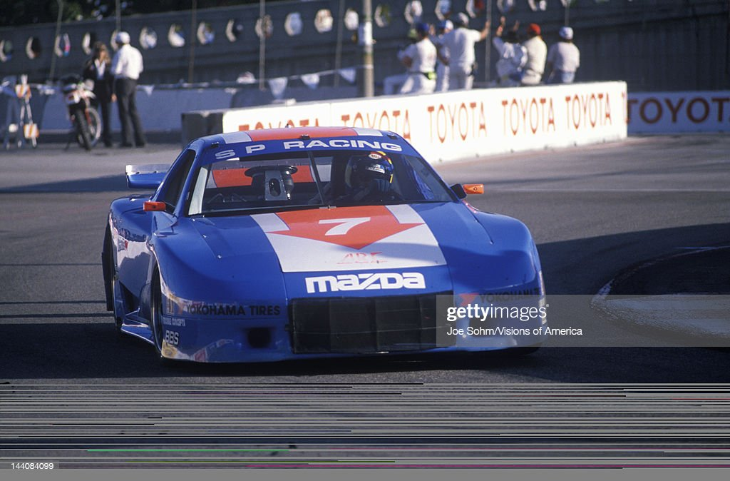 A blue Mazda Trans AM in the Toyota Grand Prix Car Race in Long ...