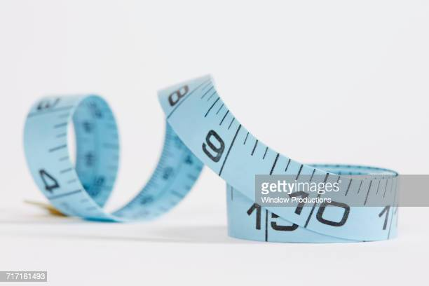 Blue measuring tape on white background