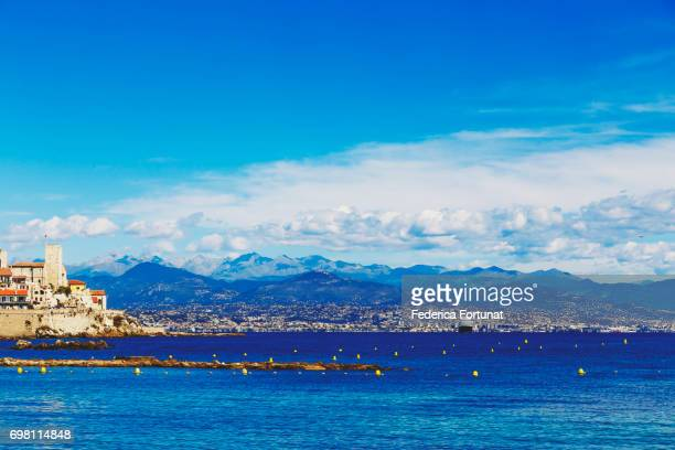 blue mediterranean landscape and antibes old town and coastline - アンティーブ ストックフォトと画像