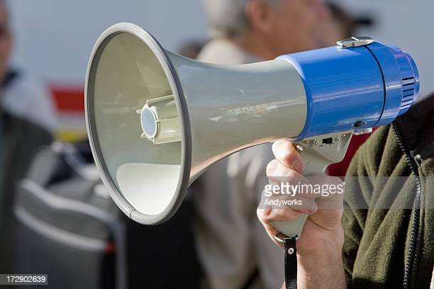 Blue megaphone being held in an action position