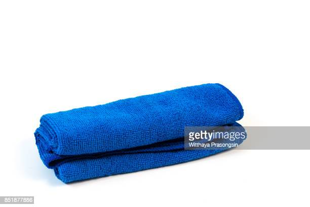 blue microfiber cloth on isolate white background - microfiber towel stock photos and pictures