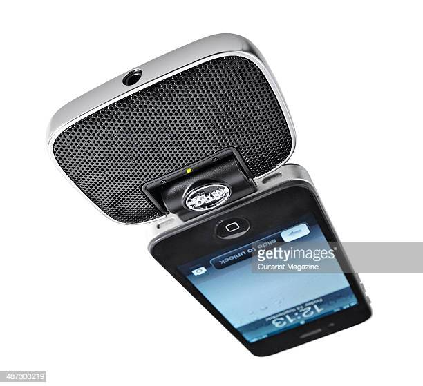 A Blue Microphones Mikey Digital portable stereo recorder attached to an Apple iPhone photographed on a white background taken on September 13 2013