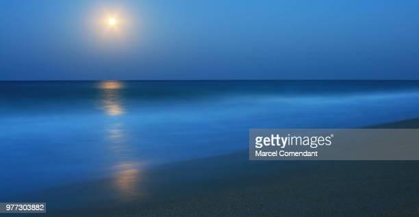 blue milky sea - luz de la luna fotografías e imágenes de stock