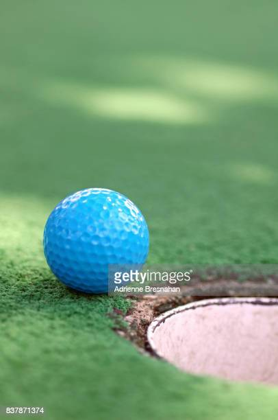 Blue Miniature Golf Ball Near the Hole