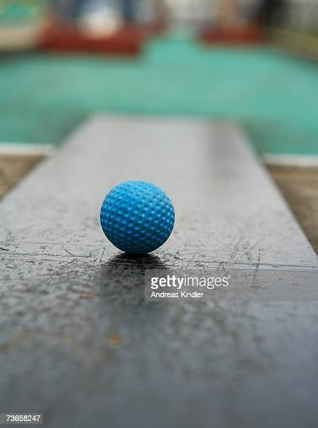 A blue minigolf ball.