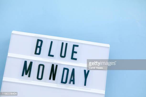 blue monday  text in lightbox - monday stock pictures, royalty-free photos & images