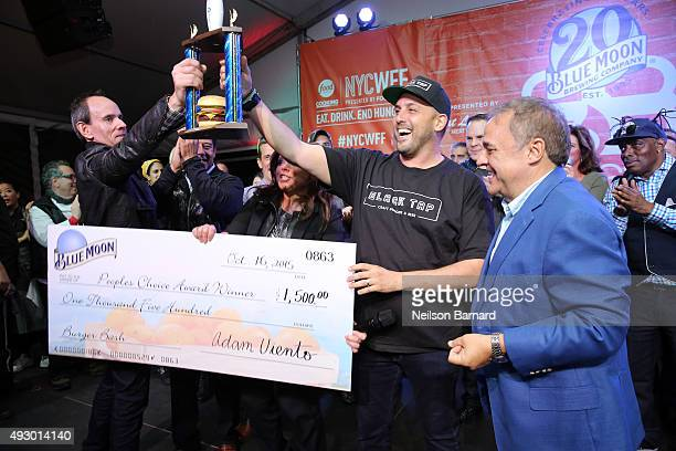 Blue Moon People's Choice Award winner Chef Joe Isidori of Black Tap and New York City Wine Food Festival Founder Executive Director Lee Brian...