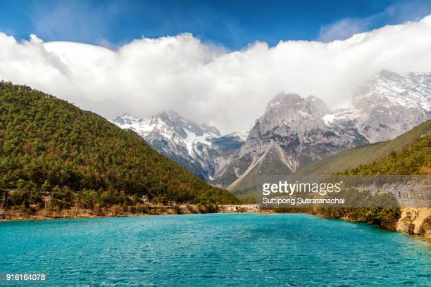 blue moon valley , white water river waterfall and jade dragon snow mountain, lijiang, yunnan china. - yunnan province stock pictures, royalty-free photos & images