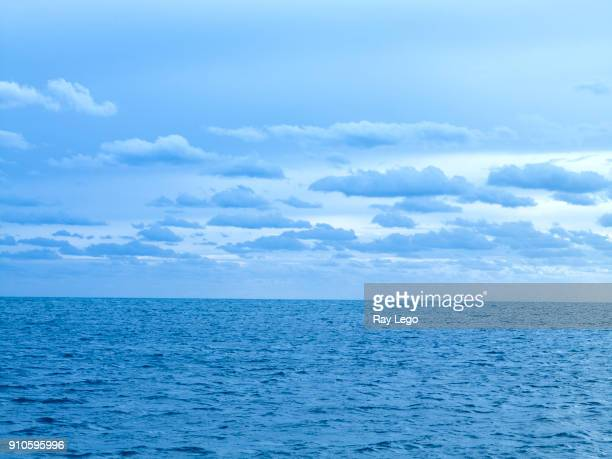 Blue morning light over the ocean with clouds, off the cost of USA.