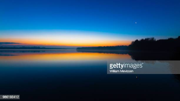 blue morning sunrise - william mevissen stockfoto's en -beelden