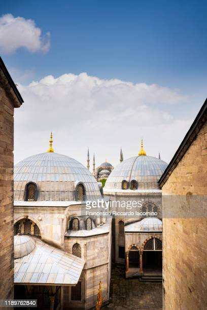 blue mosque as seen from hagia sofia, istanbul, turkey - イスタンブール県 ストックフォトと画像