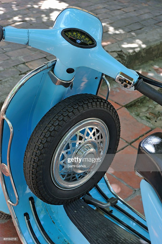 Blue motor scooter with spare tire : Stock Photo