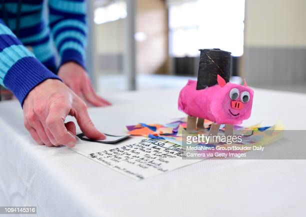 Blue Mountain Elementary School art teacher Heather Brubaker places name tags on student art for the Unframed St Vrain Valley Schools' 2016 Student...
