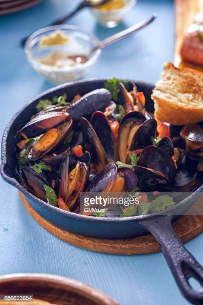 blue mussels dish with fresh parsley - mussel stock pictures, royalty-free photos & images