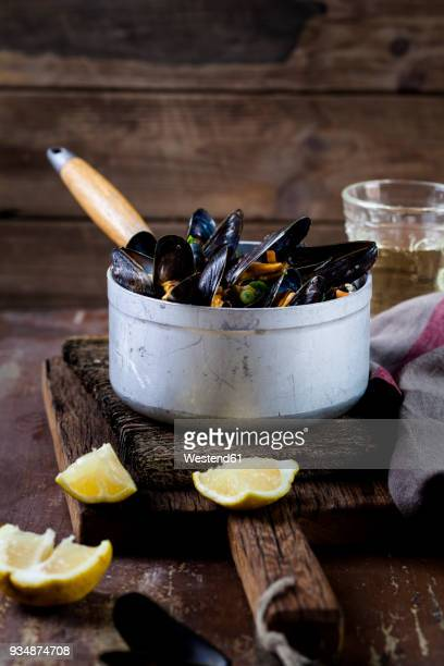 blue mussels in cooking pot - mussel stock pictures, royalty-free photos & images