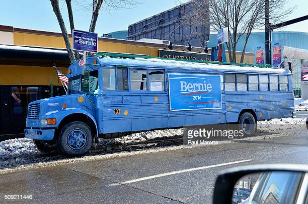 A blue 'New Hampshire for Bernie' bus is seen on Elm Street across the street from the Radisson Hotel in downtown Manchester as New Hampshire...
