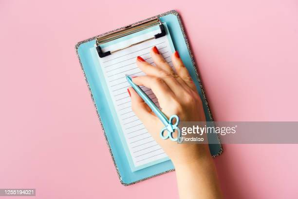 blue notebook with a sheet of paper and a pen - handwriting stock pictures, royalty-free photos & images