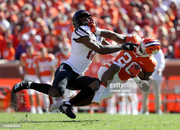 J Blue of the Louisville Cardinals tackles Tavien Feaster of the Clemson Tigers during their game at Clemson Memorial Stadium on November 3 2018 in...