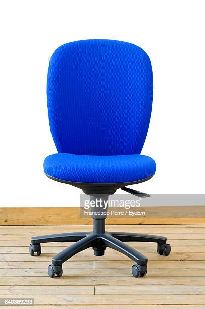 blue office chair on hardwood floor - office chair stock pictures, royalty-free photos & images