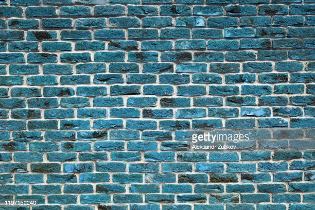blue or turquoise brick wall. the facade of the building is finished with new plaster. abstract banner. brickwork. background. texture. - building story stock pictures, royalty-free photos & images