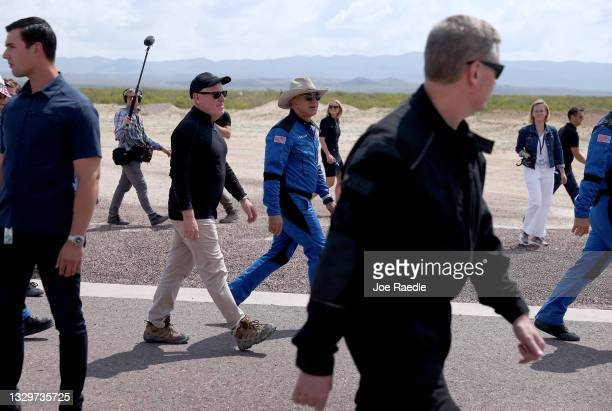 Blue Origin CEO Bob Smith walks with Jeff Bezos after his flight on Blue Origin's New Shepard into space on July 20, 2021 in Van Horn, Texas. Mr....