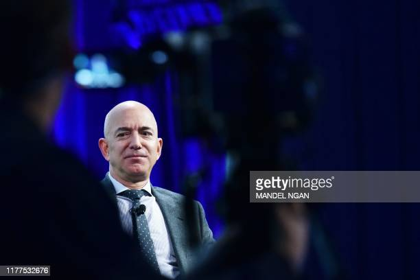 Blue Origin founder Jeff Bezos speaks after receiving the 2019 International Astronautical Federation Excellence in Industry Award during the the...