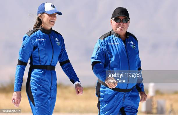 Blue Origin vice president of mission and flight operations Audrey Powers walks with Star Trek actor William Shatner to a media availability on the...