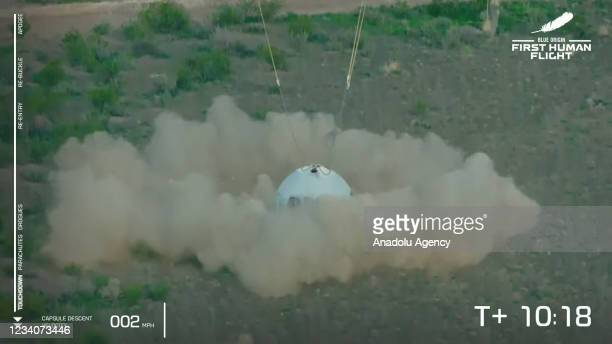 Blue Originâs New Shepard crew capsule lands on the end of its parachute system carrying Jeff Bezos along with his brother Mark Bezos, 18-year-old...