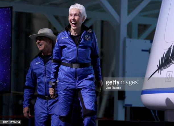 Blue Origin's New Shepard crew Jeff Bezos and Wally Funk arrive for a press conference after flying into space in the Blue Origin New Shepard rocket...