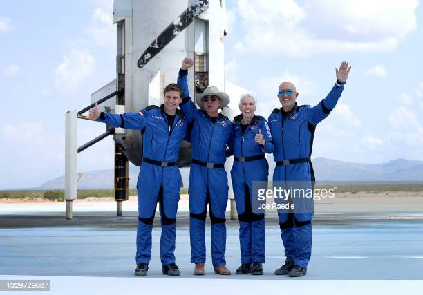 Blue Origin's New Shepard crew Oliver Daemen, Jeff Bezos, Wally Funk, and Mark Bezos pose for a picture after flying into space in the Blue Origin...