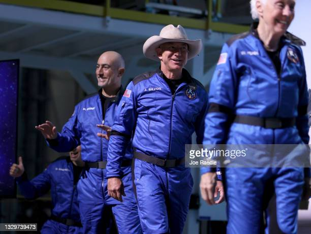Blue Origin's New Shepard crew Oliver Daemen , Mark Bezos, Jeff Bezos, and Wally Funk arrive for a press conference after flying into space in the...