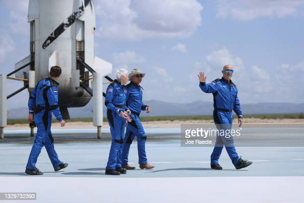 Blue Origin's New Shepard crew Oliver Daemen, Wally Funk, Jeff Bezos, and Mark Bezos walk near the ship after flying into space on July 20, 2021 in...