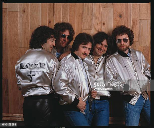 Blue Oyster Cult members pose in matching silver jackets From left to right Albert Bouchard Allen Lanier Donald 'Buck Dharma' Roeser Joe Bouchard and...