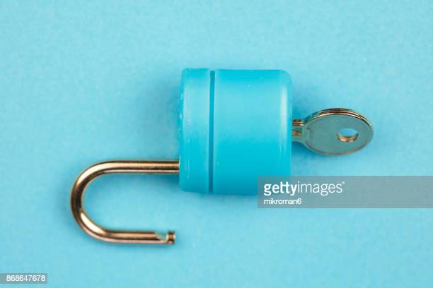 blue padlock with key on blue background - accessibility stock pictures, royalty-free photos & images