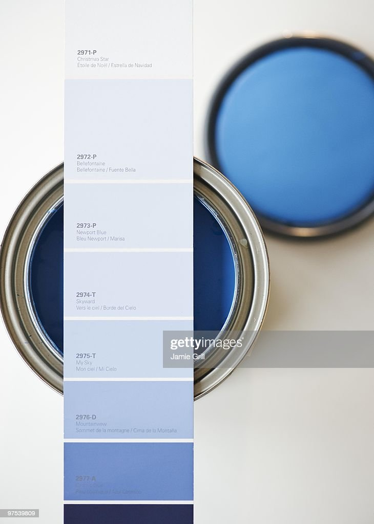 Blue paint swatch over corresponding paint can : Stock Photo