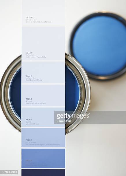 blue paint swatch over corresponding paint can - lid stock photos and pictures