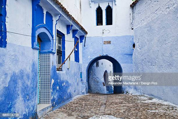 Blue painted buildings in the backstreets of Chefchaouen medina