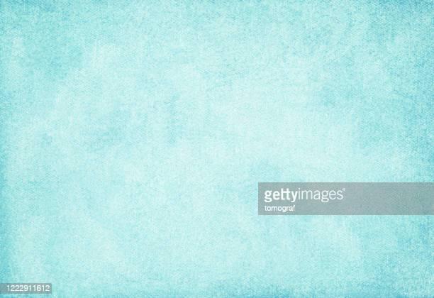 fondo abstracto de papel azul - irregular texturizado fotografías e imágenes de stock