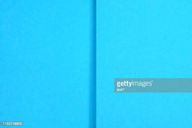 blue paper background - geschichtet stock-fotos und bilder