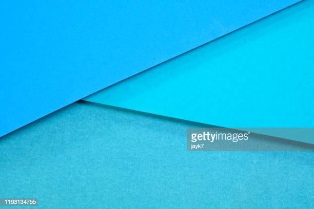 blue paper background - mehrschichtig stock-fotos und bilder