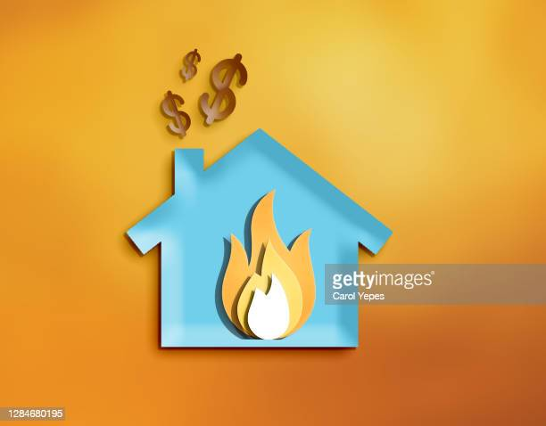 blue paper house with fire inside.secure home insurance concept - commercial real estate sign stock pictures, royalty-free photos & images