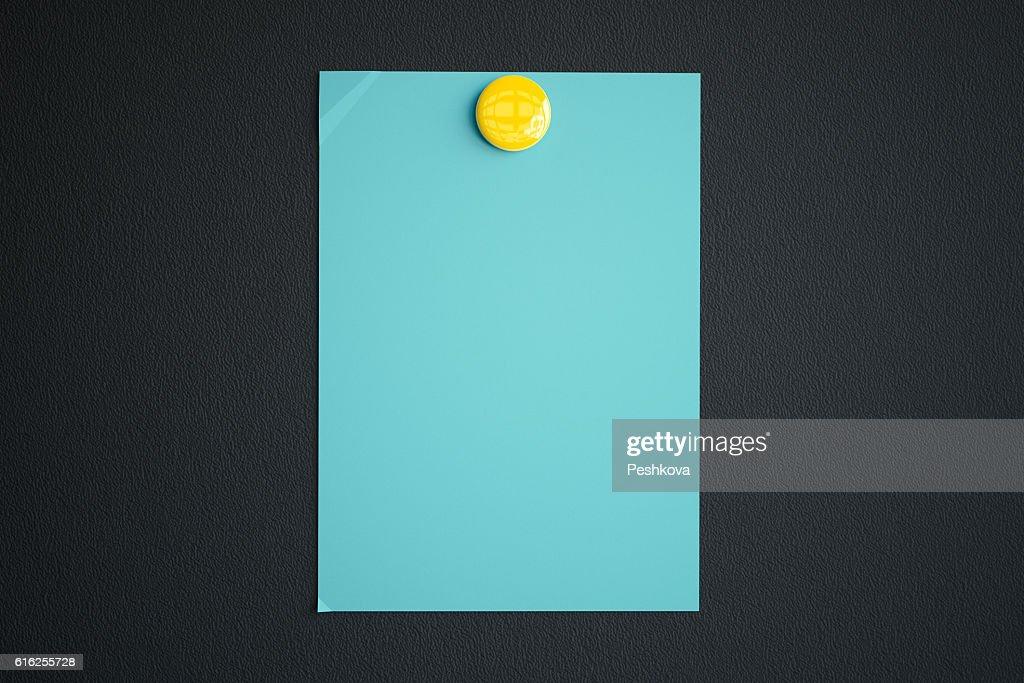 Blue paper sheet with magnet : Foto de stock