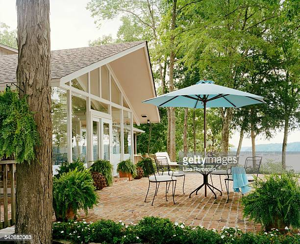 Blue patio table and chairs at lake house