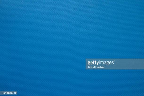 blue patterned background - エクササイズマット ストックフォトと画像
