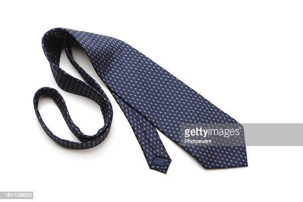 blue patterned necktie laying on white background - tie stock pictures, royalty-free photos & images